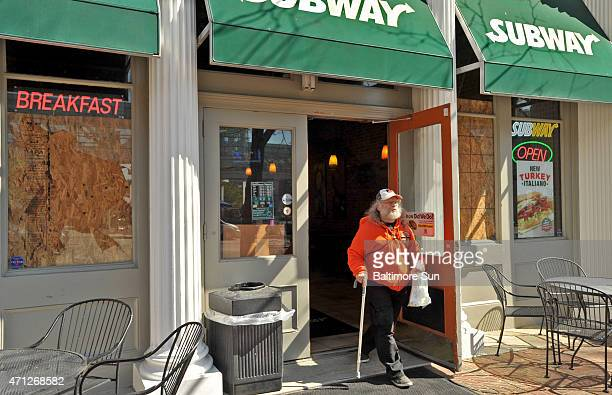 Alan Schwartz stops for food at a Subway restaurant in Baltimore which was open despite boardedup windows before heading to the Orioles game on...