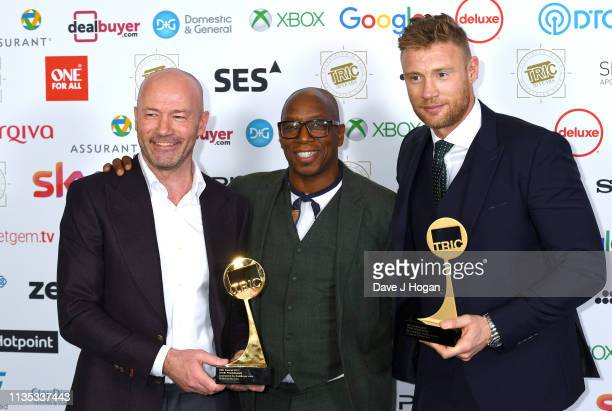 Alan Sheaer, Ian Wright and Andrew Flintoff pose with awards for Sport Programme during the 2019 'TRIC Awards' held at The Grosvenor House Hotel on...