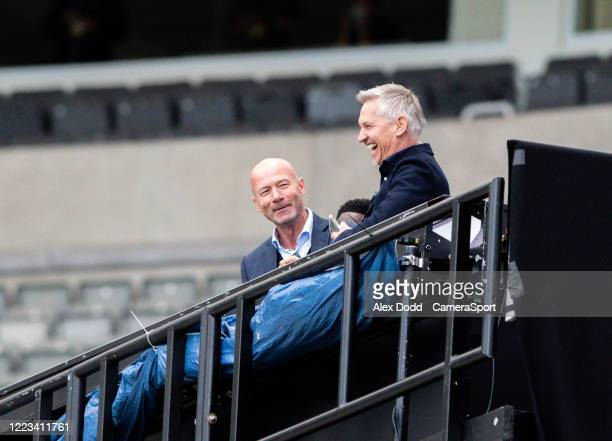 Alan Shearer and Gary Lineker share a joke from their makeshift BBC studio during the FA Cup Quarter Final match between Newcastle United and...