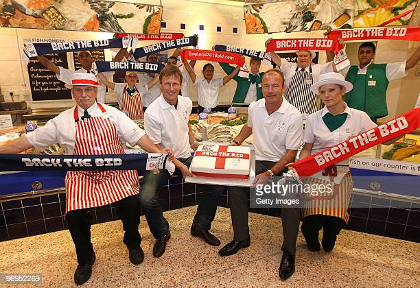 Alan Shearer and Teddy Sheringham pose for the media alongside members of staff from Morrisons Queensbury during a photo call to promote the launch...