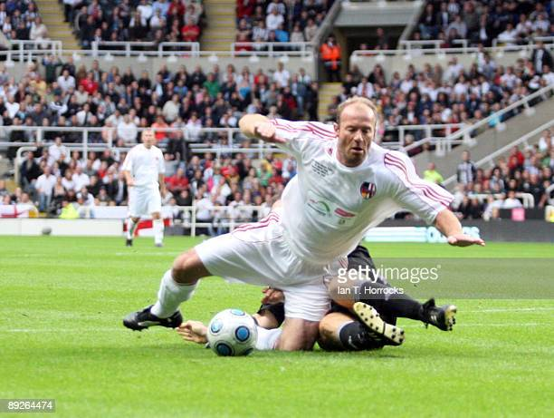 Alan Shearer is brought down in the box for a penalty during the England v Germany charity match in aid of the Bobby Robson Foundation at St James'...