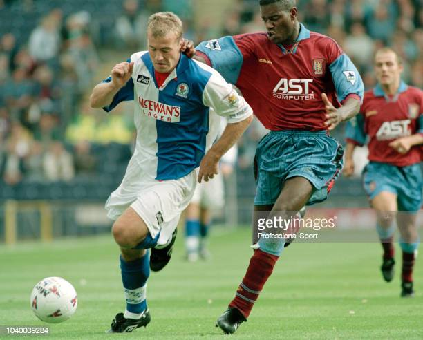 Alan Shearer of Blackburn Rovers takes on Ian Taylor of Aston Villa during an FA Carling Premiership match at Ewood Park on September 9 1995 in...