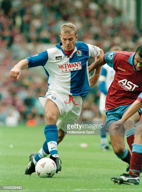 Alan Shearer of Blackburn Rovers takes on Paul McGrath of Aston Villa during an FA Carling Premiership match at Ewood Park on September 9 1995 in...