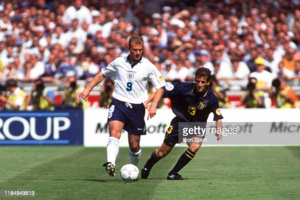 Alan Shearer of England and Tosh McKinlay of Scotland during the European Championship match between Scotland and England at Wembley Stadium London...