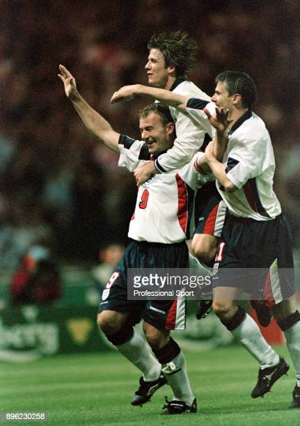Alan Shearer of England celebrates after scoring with David Beckham and Rob Lee during the 1998 FIFA World Cup Qualifier between England and Georgia...
