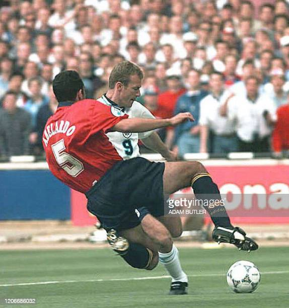 Alan Shearer of England is brought down by a tackle from Fernandez Abelardo of Spain in the opening seconds of the Euro 96 quarter final clash...