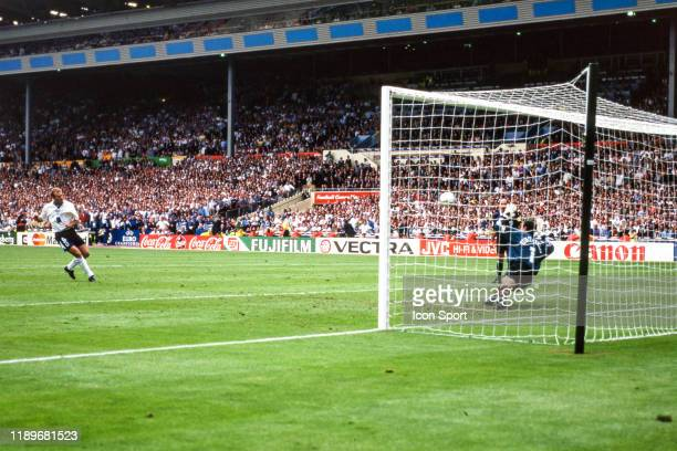 Alan Shearer of England score his penalty against Andoni Zubizarreta of Spain during the Quarter Final of European Championship match between Spain...