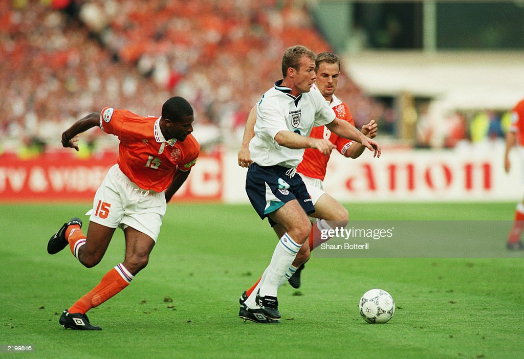 Alan Shearer of England and Winston Bogarde of Holland : News Photo