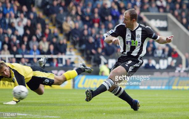 Alan Shearer of Newcastle scores past Carlo Nash of Manchester City during the FA Barclaycard Premiership game between Newcastle United and...