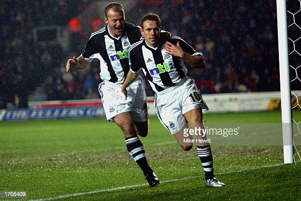 Alan Shearer of Newcastle United congratulates team mate Craig Bellamy of Newcastle United after scoring the first goal during the FA Barclaycard...