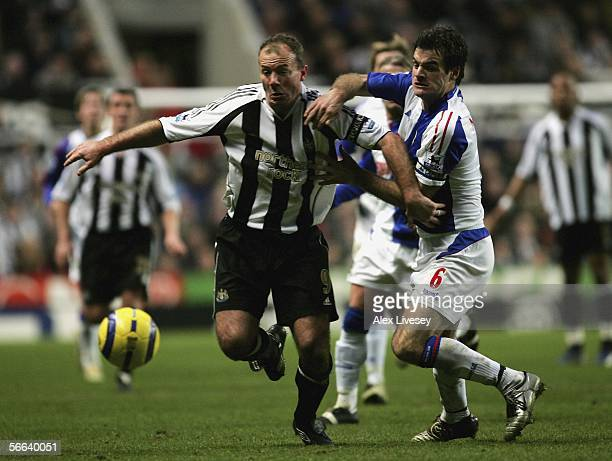 Alan Shearer of Newcastle United holds off a challenge from Ryan Nelson of Blackburn Rovers during the Barclays Premiership match between Newcastle...