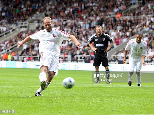 Alan Shearer scores a penalty to make it 32 during the England v Germany charity match in aid of the Bobby Robson Foundation at St James' Park on...
