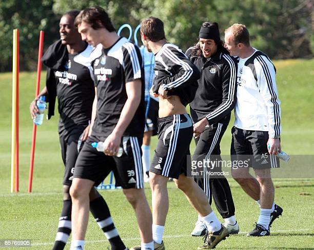 Alan Shearer talks to Jonas Gutierrez during a Newcastle United team training session at the Little Benton Training Ground on April 2 2009 in...