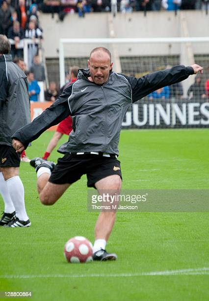 Alan Shearer warms up prior to taking the field for Newcastle against Liverpool in the 'Entertainers Reunited' charity football match on October 9...