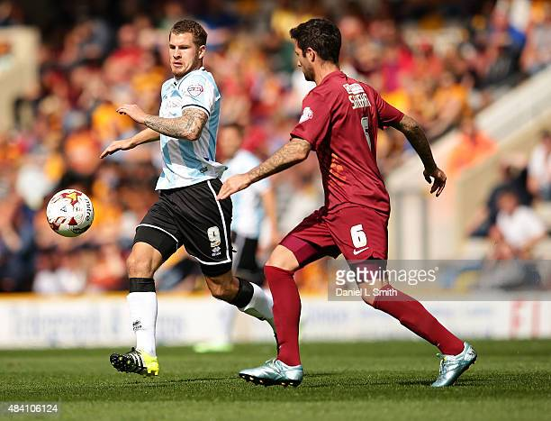 Alan Sheehan of Bradford City AFC and James Collins of Shrewsbury Town FC compete for the ball during the League One match between Bradford City AFC...