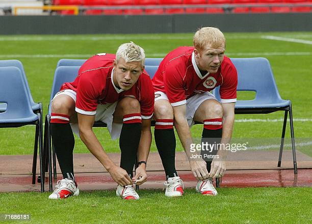 Alan Smith and Paul Scholes of Manchester United takes part in the official Manchester United team photocall at Old Trafford on August 21 2006 in...