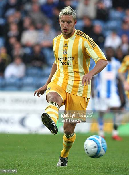 Alan Smith in action during a preseason friendly match between Huddersfield Town and Newcastle United at the Galpharm Stadium on July 21 2009 in...