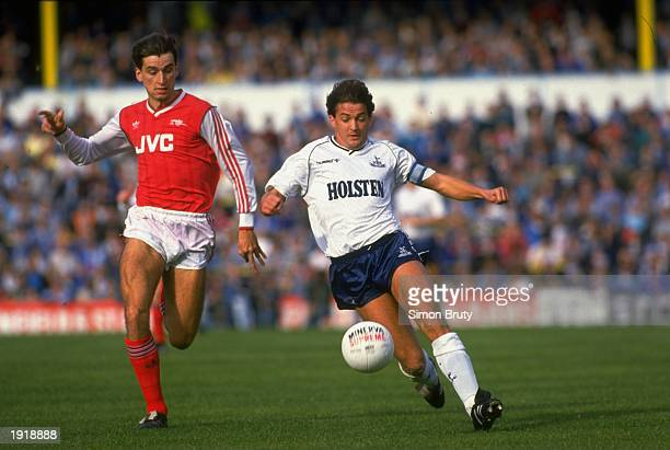 Alan Smith of Arsenal and Gary Mabbutt of Tottenham Hotspur both go for the ball during the Division One match at White Hart Lane in Tottenham London...