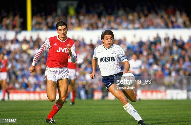 Alan Smith of Arsenal takes on Gary Mabbutt of Tottenham Hotspur during a match at White Hart Lane in London Arsenal won the match 21 Mandatory...