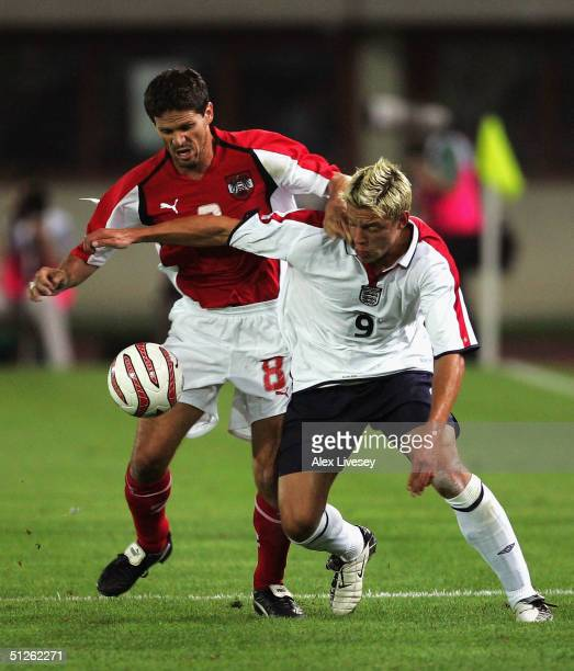 Alan Smith of England battles for the ball with Dietmar Kuhbauer of Austria during the 2006 FIFA World Cup Qualifying game between Austria and...