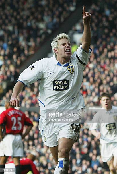 Alan Smith of Leeds celebrates after scoring the equalising goal during the FA Barclaycard Premiership match between Manchester United and Leeds...