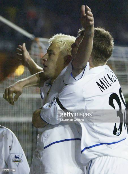 Alan Smith of Leeds celebrates his goal with James Milner during the FA Barclaycard Premiership match between Leeds United and Leicester City at...