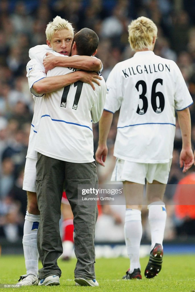 Alan Smith of Leeds consoles a tearfull fan as his side are relagated during the FA Barclaycard Premiership match between Leeds United and Charlton Athletic at Elland Road on May 8, 2004 in Leeds, England.
