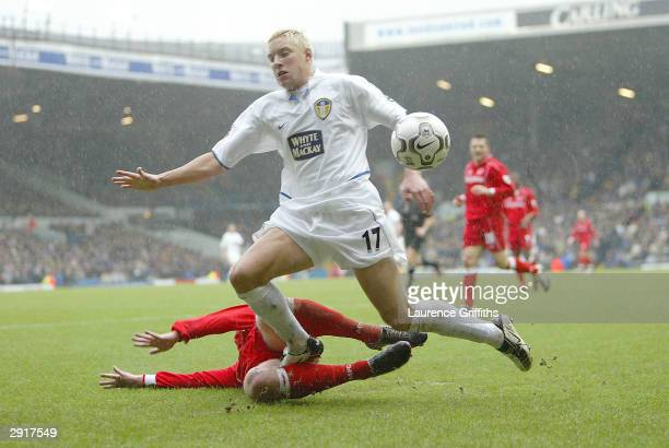 Alan Smith of Leeds is felled by Andrew Davies of Middlesbrough during the FA Barclaycard Premiership match between Leeds United and Middlesbrough at...