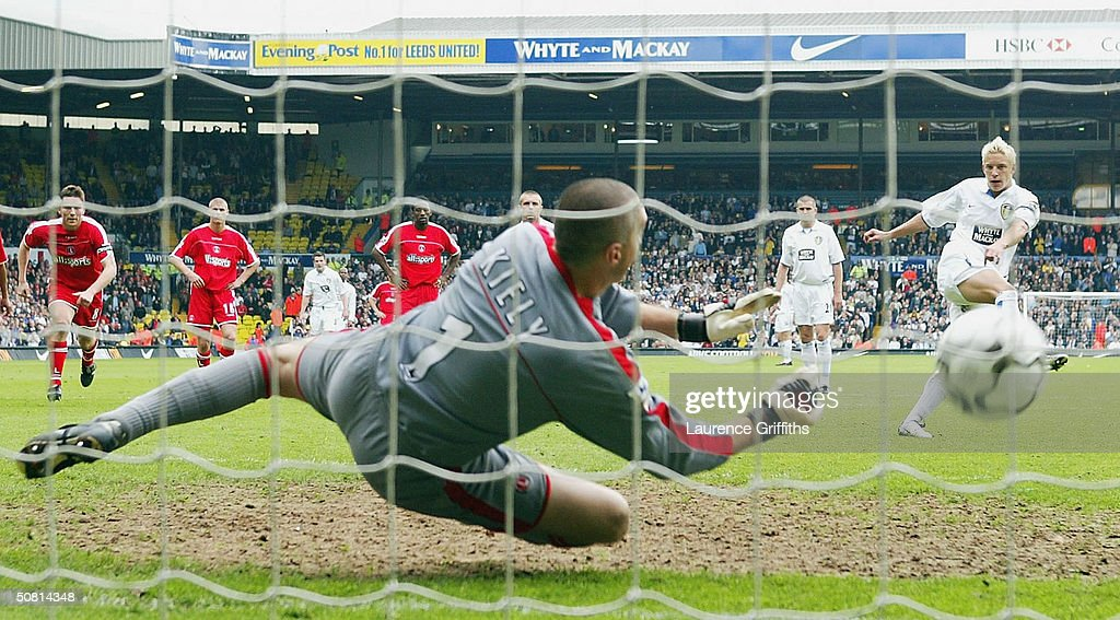 Alan Smith of Leeds scores past Dean Kiely of Charlton during the FA Barclaycard Premiership match between Leeds United and Charlton Athletic at Elland Road on May 8, 2004 in Leeds, England.