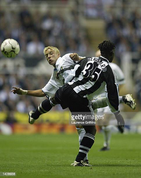 Alan Smith of Leeds United and Olivier Bernard of Newcastle United in action during the FA Barclaycard Premiership game between Newcastle United and...