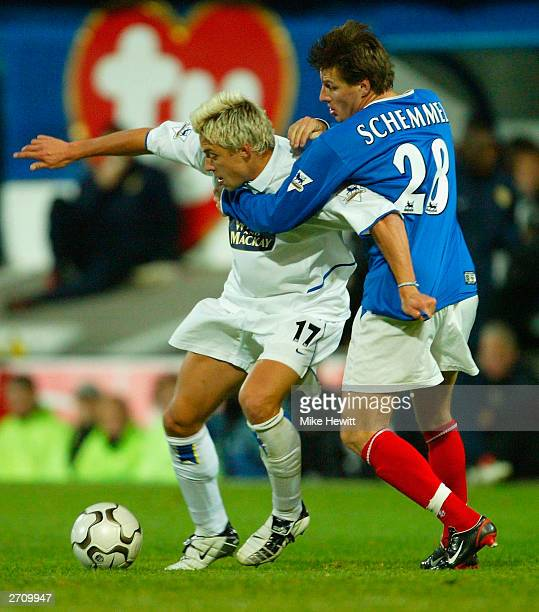 Alan Smith of Leeds United battles with Sebastien Schemmel of Portsmouth during the FA Barclaycard Premiership match between Portsmouth and Leeds...