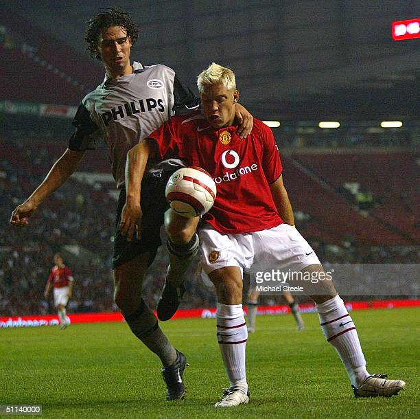 Alan Smith of Man Utd clashes with John de Jong of PSV during the Vodafone Cup match between Manchester United and PSV Eindhoven at Old Trafford on...