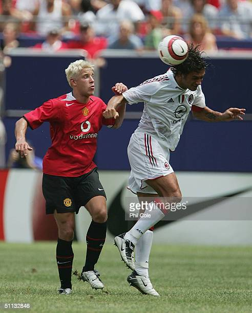 Alan Smith of Manchester United and Paolo Maldini of AC Milan in the Champions World Series at Giants Stadium July 31, 2004 in East Rutherford, New...