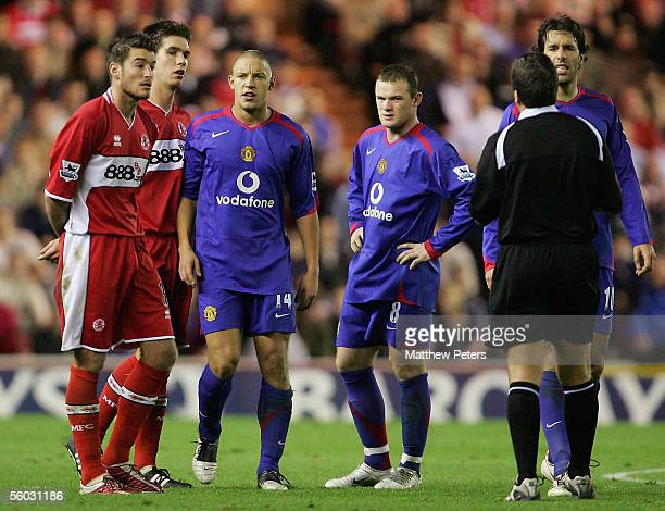 Alan Smith of Manchester United argues with Franck Quedreu of Middlesbrough in front of referee Alan Wylie during the Barclays Premiership match...