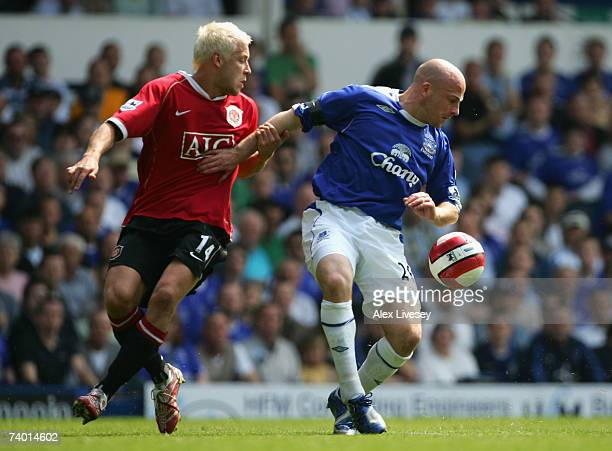 Alan Smith of Manchester United battles for the ball with Lee Carsley of Everton during the Barclays Premiership match between Everton and Manchester...