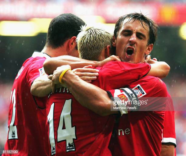 Alan Smith of Manchester United celebrates scoring the second goal of the game with John O'Shea and Gary Neville during the Community Shield match...