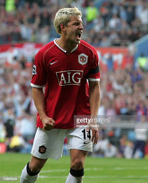 Alan Smith of Manchester United celebrates Wayne Rooney scoring his team's third goal during the FA Cup sponsored by E.ON Semi-final match between...