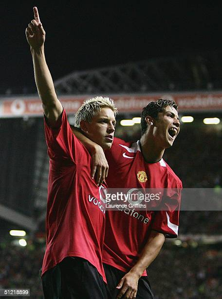 Alan Smith of Manchester United celebrates with Cristiano Ronaldo after scoring the second goal during the UEFA Champions League Third Round...