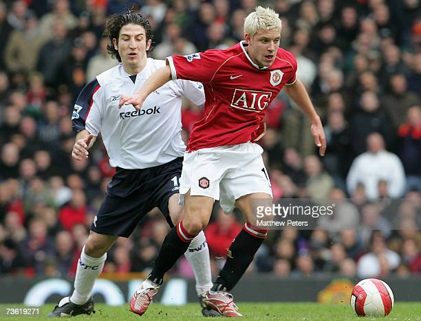 Alan Smith of Manchester United clashes with Andranik Teymourian of Bolton Wanderers during the Barclays Premiership match between Manchester United...