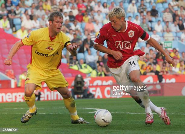 Alan Smith of Manchester United clashes with Jay Demerit of Watford during the FA Cup sponsored by EON Semifinal match between Watford and Manchester...