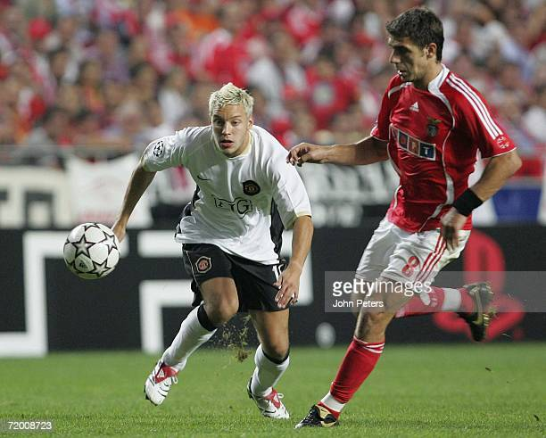 Alan Smith of Manchester United clashes with Konstantinos Katsouranis of Benfica during the UEFA Champions League match between Benfica and...