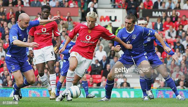 Alan Smith of Manchester United clashes with Lee Carsley and Alan Stubbs of Everton during the Barclays Premiership match between Manchester United...