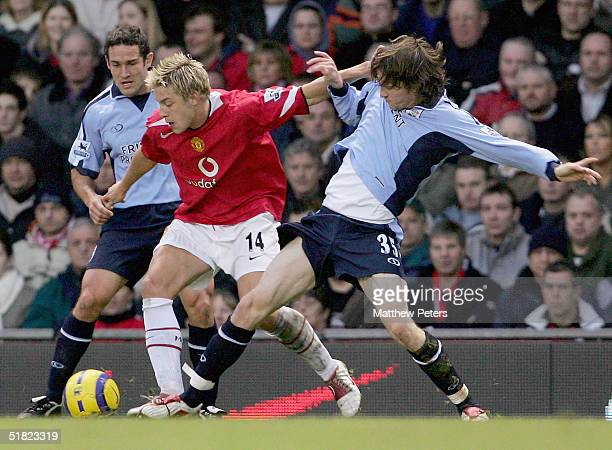Alan Smith of Manchester United clashes with Mikael Nilsson of Southampton during the Barclays Premiership match between Manchester United and...