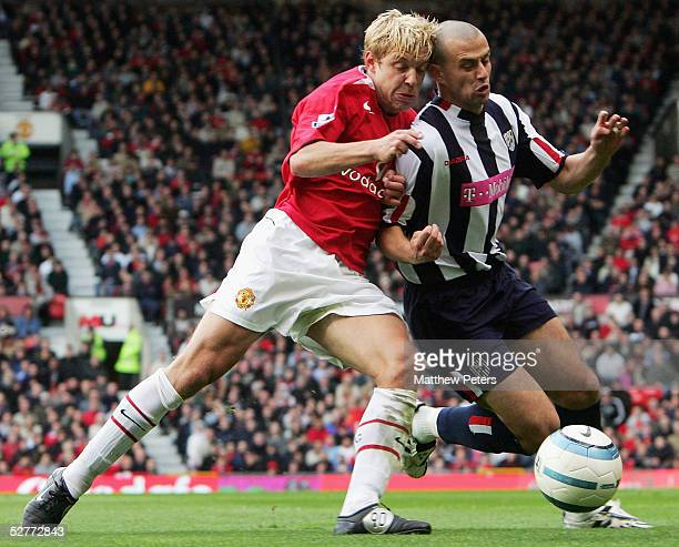 Alan Smith of Manchester United clashes with Neil Clement of West Bromwich Albion during the Barclays Premiership match between Manchester United and...
