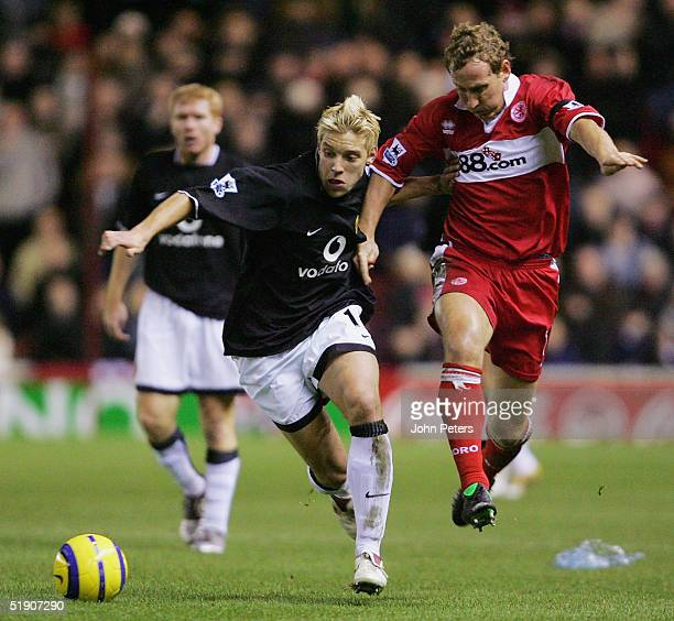 Alan Smith of Manchester United clashes with Ray Parlour of Middlesbrough during the Barclays Premiership match between Middlesbrough and Manchester...