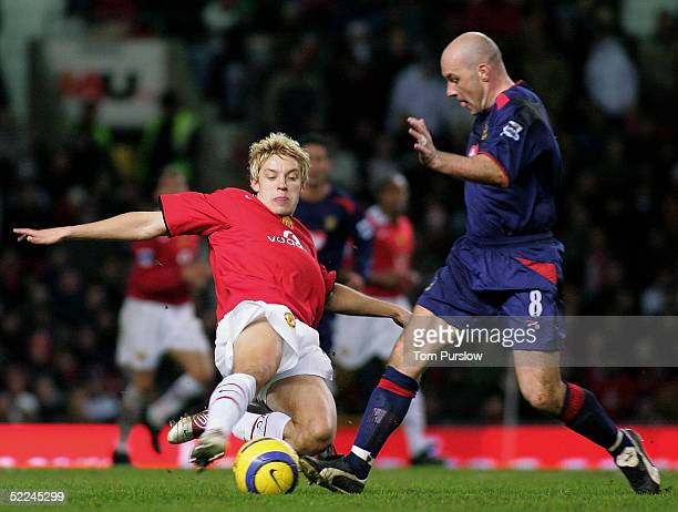 Alan Smith of Manchester United clashes with Steve Stone of Portsmouth during the Barclays Premiership match between Manchester United and Portsmouth...