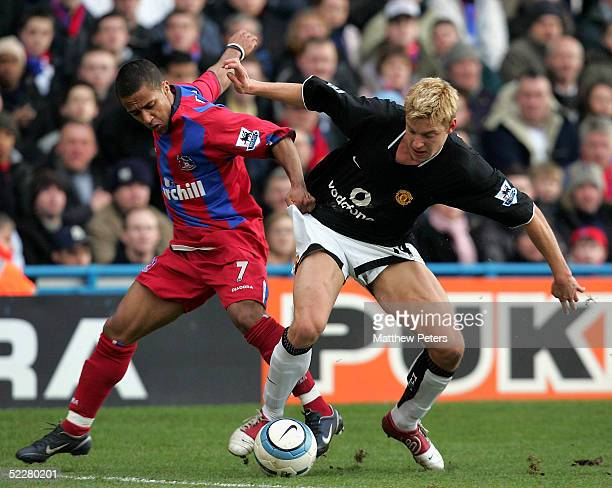 Alan Smith of Manchester United clashes with Wayne Routledge of Crystal Palace during the Barclays Premiership match between Crystal Palace and...