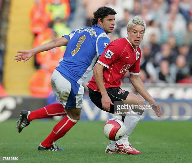 Alan Smith of Manchester United in action against Dejan Stefanovic of Portsmouth during the Barclays Premiership match between Portsmouth and...