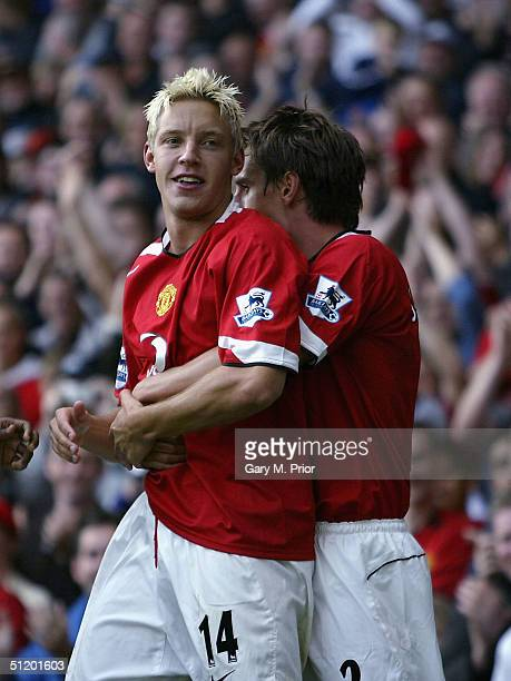 Alan Smith of Manchester United is congratulated by his team mate Gary Neville after Smith's goal during the FA Barclays Premiership match between...