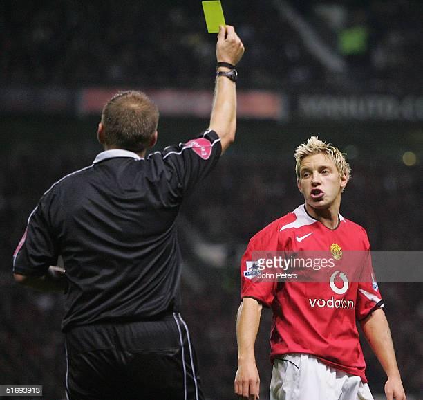 Alan Smith of Manchester United is shown the yellow card by referee Graham Poll during the Barclays Premiership match between Manchester United and...